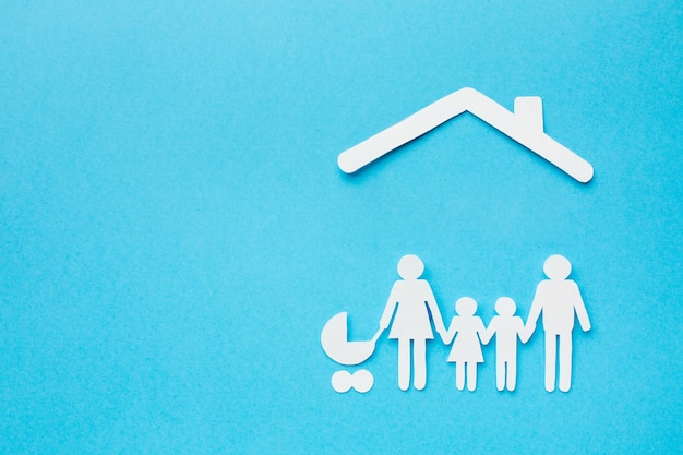 Concepto de hogar de figura familiar de vista superior Foto gratis