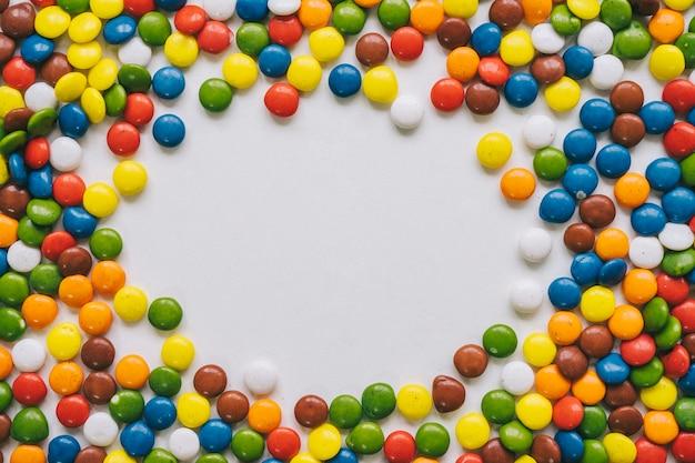 Concepto de marco de caramelos coloridos | Descargar Fotos gratis