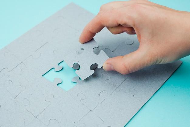 Concepto de negocios con puzzle Foto gratis