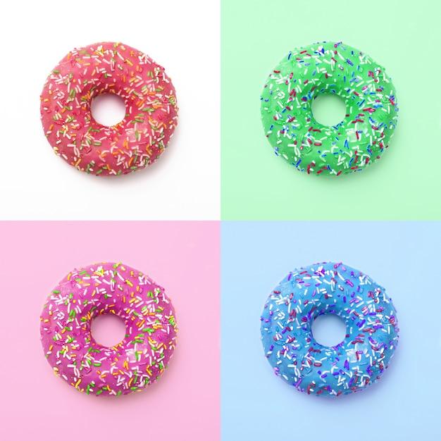 Conjunto de donas de colores. excelente fresca deliciosa púrpura verde azul rosa donut en formación de hielo. collage Foto Premium