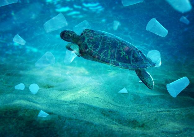 Contaminación plástica en el problema ambiental del océano las tortugas pueden comer plásticos pensando que son medusas Foto Premium