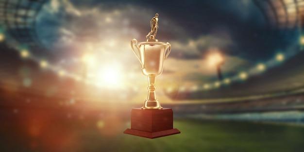Copa de oro en el fondo del estadio. Foto Premium
