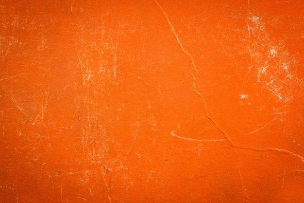 Una cubierta de libro de tela vintage con patrón de pantalla naranja Foto Premium