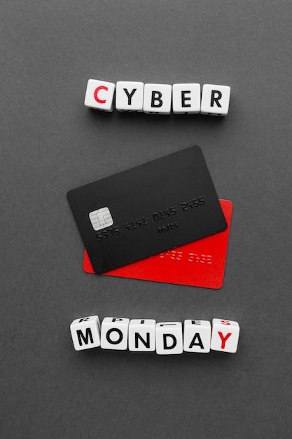 Cyber monday con tarjetas de crédito negras y rojas Foto gratis