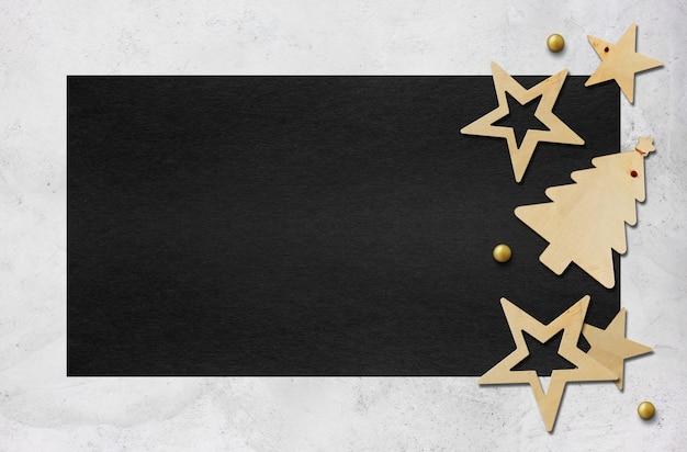 Decoración navideña sobre papel negro Foto Premium