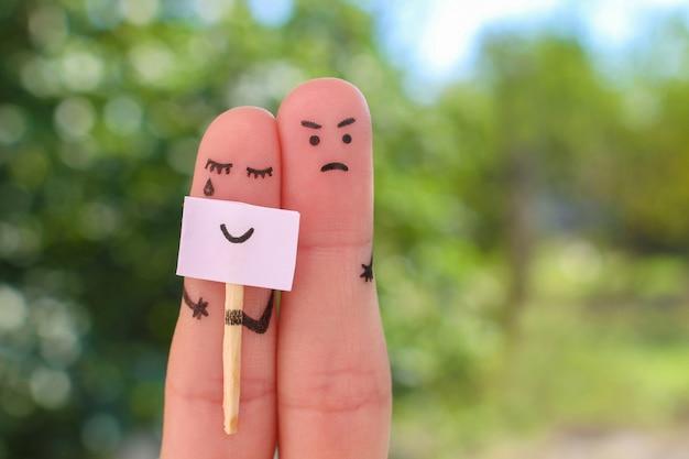 Dedos arte de pareja. concepto de mujer ocultando emociones, el hombre está insatisfecho. Foto Premium