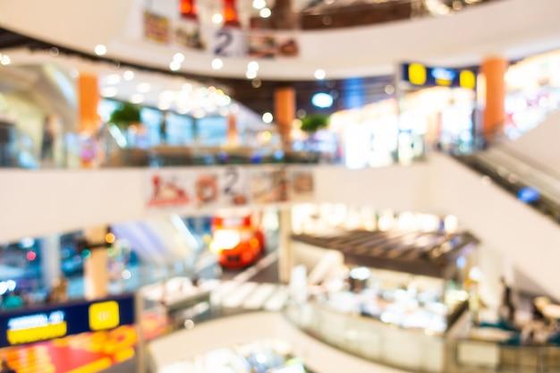 Desenfoque abstracto y centro comercial desenfocado e interior minorista de grandes almacenes, fondo borroso de la foto Foto gratis