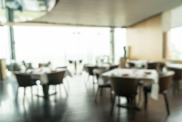 Desenfoque abstracto y desayuno buffet desenfocado en el interior del restaurante del hotel Foto Premium