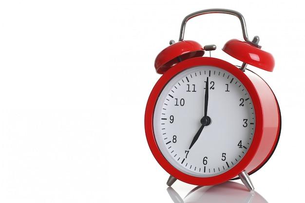 Despertador rojo aislado Foto Premium