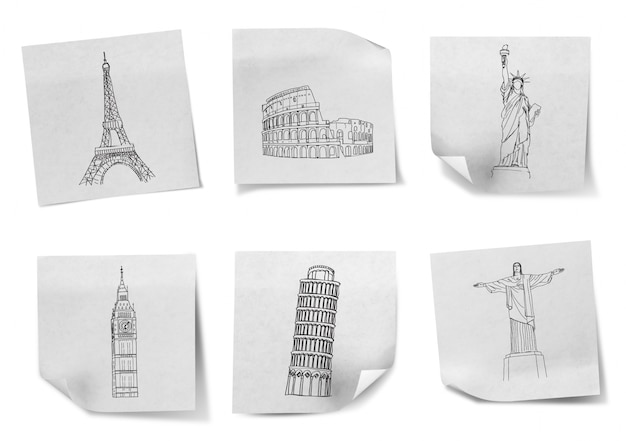 Dibujo viajar por todo el mundo en los papeles de nota blancas (francia, es Foto gratis