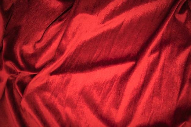 4ab93100e15ac Doble fondo de textura de tela de terciopelo rojo ondulado suave ...
