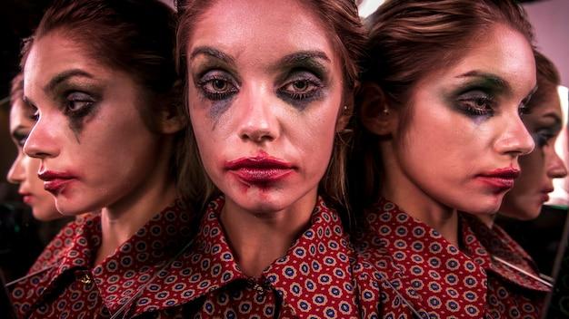 Efecto espejo múltiple de mujer posando desde diferentes ángulos Foto gratis