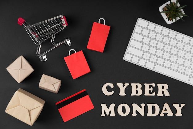 Elementos de venta de cyber monday de vista superior sobre fondo oscuro Foto gratis
