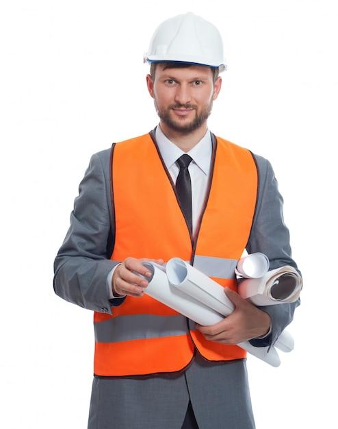 Empresario maduro construccionista sonriendo aislado en blanco Foto gratis