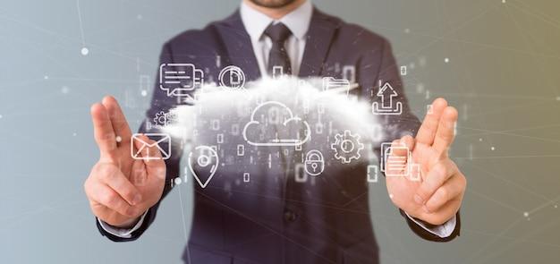 Empresario sosteniendo una nube de representación multimedia icono 3d Foto Premium