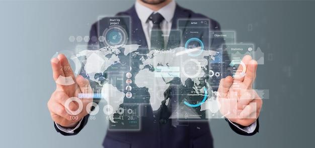 Empresario sosteniendo pantallas de interfaz de usuario con representación 3d de iconos, estadísticas y datos Foto Premium
