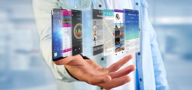 Empresario sosteniendo la plantilla de la aplicación en un teléfono inteligente Foto Premium