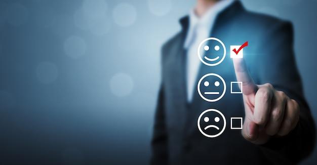Los empresarios eligen calificar los íconos felices Foto Premium