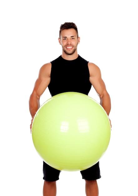 Entrenador personal con una gran pelota aislada en un fondo blanco ... 71c574e2b509