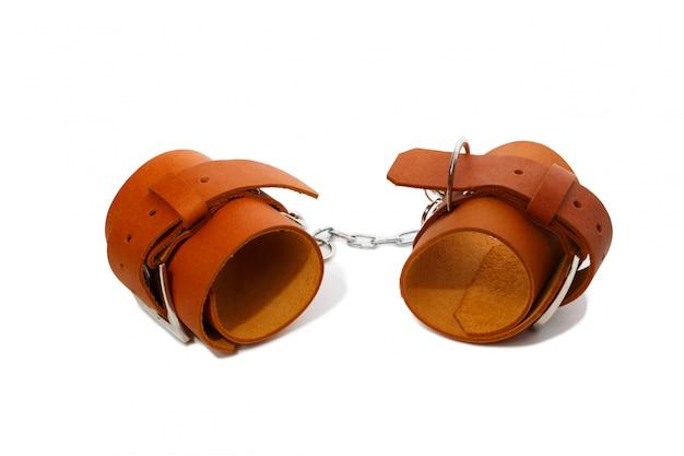 Esposas de cuero marrón claro Foto Premium