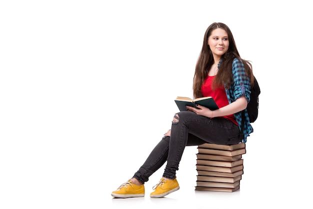 Estudiante con muchos libros aislados en el blanco Foto Premium