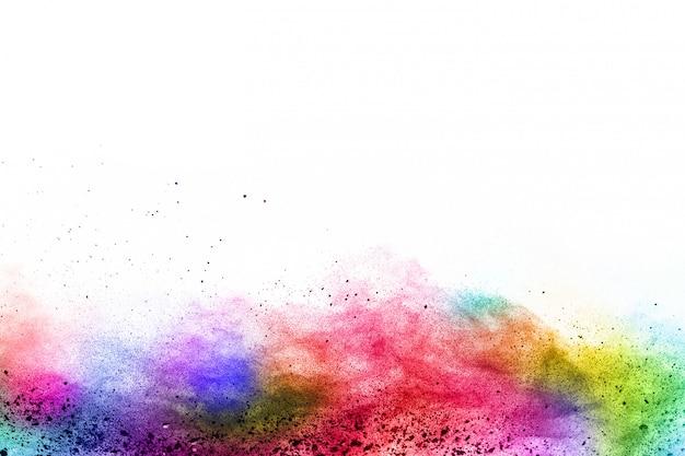 Explosión colorida del polvo en el fondo blanco. Foto Premium
