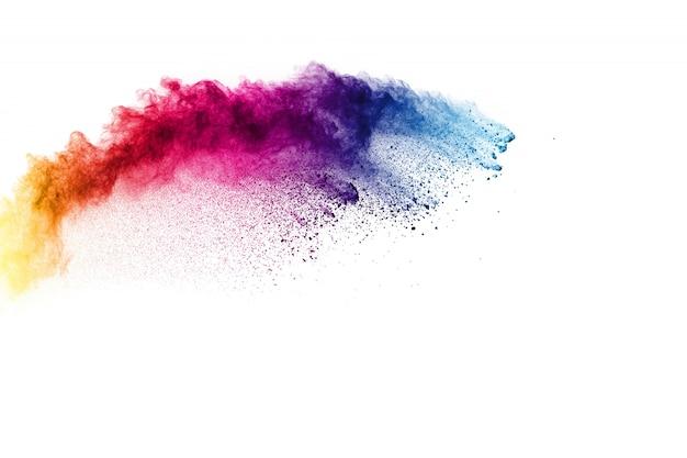 Explosión de polvo de colores salpicaduras de partículas de polvo de color pastel. Foto Premium
