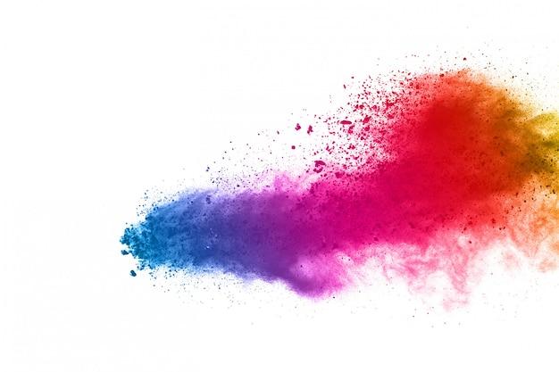 Explosión de polvo colorido sobre fondo blanco. Foto Premium