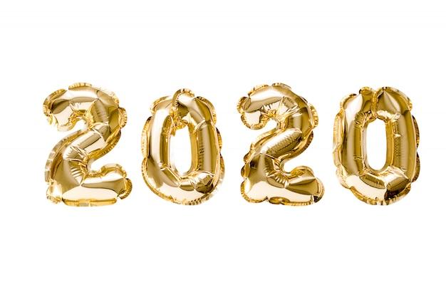 Feliz año nuevo 2020 celebración. lámina de oro globos número 2020 aislado Foto Premium
