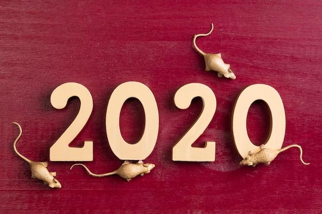 Figuritas de rata dorada para año nuevo chino Foto gratis
