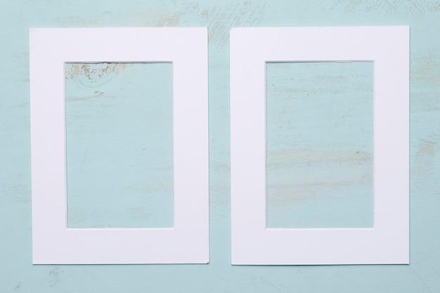Flat lay de marco con concepto floral Foto gratis