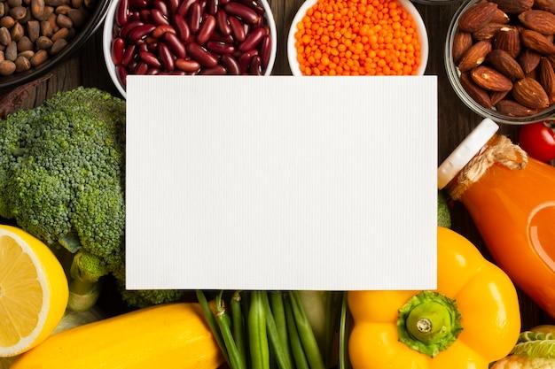 Flay pone de comestibles con maqueta Foto gratis