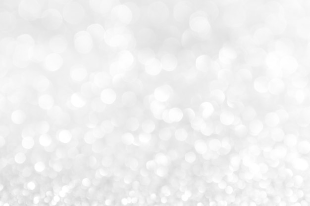 Fondo abstracto blanco luces de plata en bokeh de navidad Foto Premium