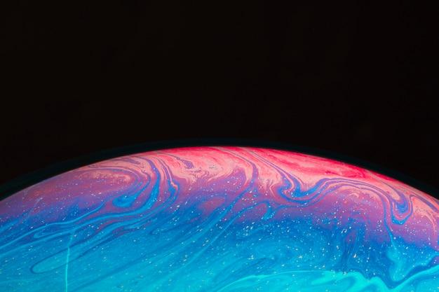 Fondo abstracto con esfera rosa y azul brillante Foto gratis