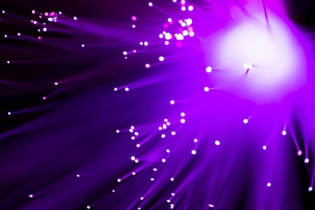 Fondo abstracto de luces de fibra óptica violeta Foto gratis