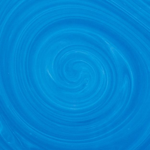 Fondo de arte fluido azul y blanco mezcla de colores remolino Foto gratis