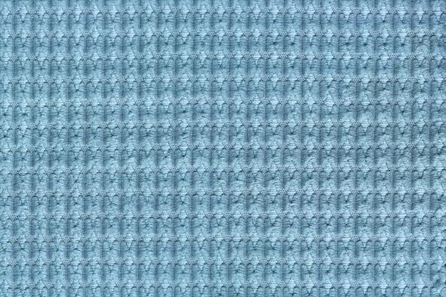 Fondo azul claro del cierre suave de la tela lanosa para arriba. textura de macro textil Foto Premium