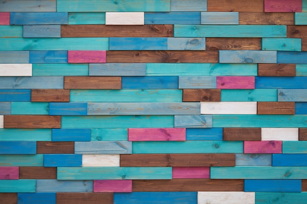 Fondo de barras de madera marrón, turquesa, azul, rosa y blanco. Foto Premium