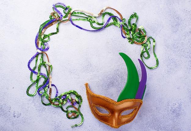 Fondo de carnaval con máscara de carnaval Foto Premium