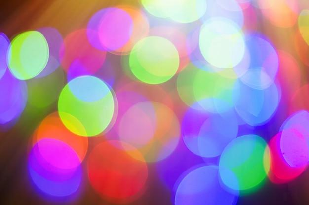 Fondo colorido bokeh para saludo o tarjeta de navidad Foto Premium