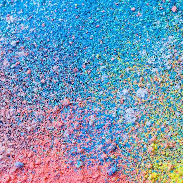 Fondo colorido de polvo de tiza. partículas de polvo multicolores salpicadas. Foto Premium