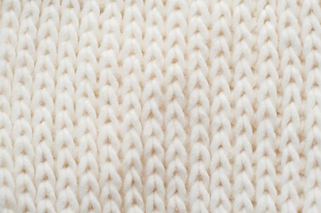 Fondo de cosa tejida ligera remolino Foto Premium