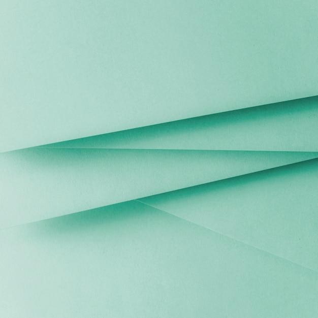 Fondo de la endecha plana geométrica del papel del color en colores pastel Foto gratis