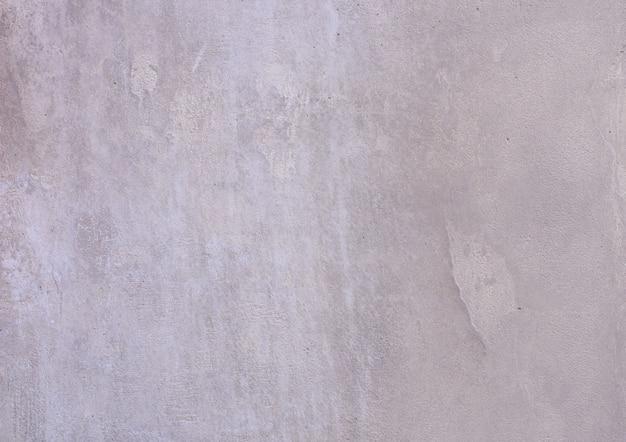 Fondo de un exterior de estuco gris pintado y pintado, fundición rugosa de cemento y textura de muro de hormigón Foto Premium