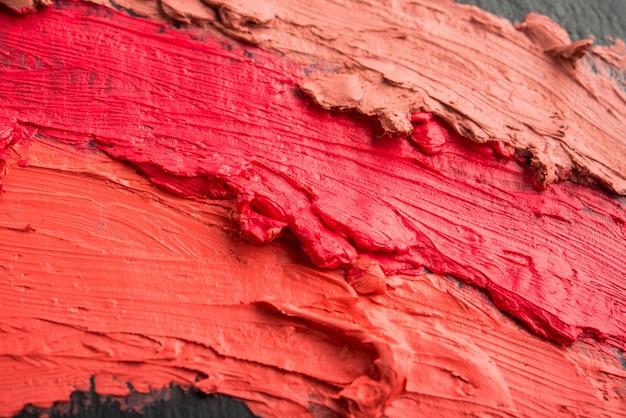 Fondo de lápiz labial colorido manchado Foto Premium