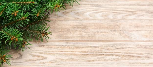 Fondo de madera gris de navidad con abeto y copia espacio. vista superior espacio vacío Foto Premium