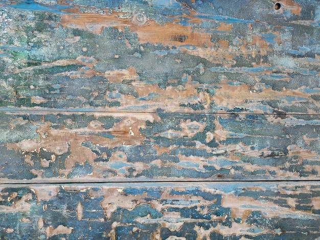 Fondo de madera vintage con pintura descascarada Foto gratis