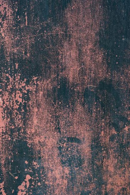 Fondo de metal rojo oxidado grunge o textura con arañazos y grietas Foto gratis