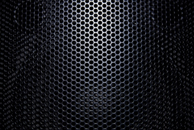 Fondo negro de rejilla protectora con luz. Foto Premium