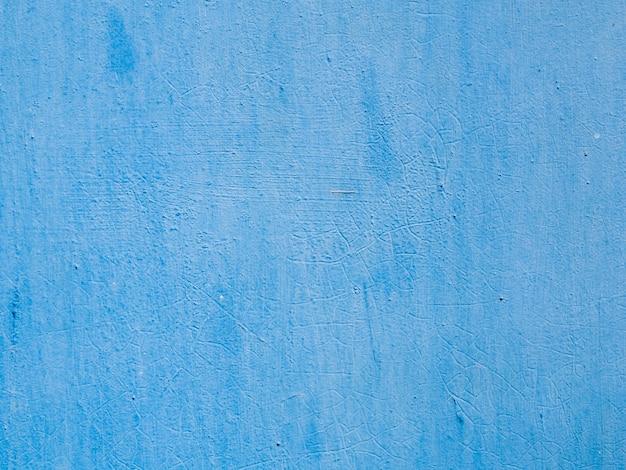 Fondo de pared con textura pintada de azul Foto gratis